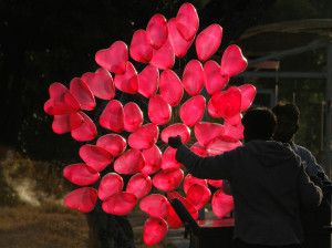 red heart shaped helium balloons